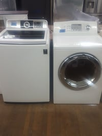 white top-load and front-load clothes washer and dryer set