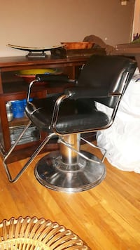 barber's black and grey swivel chair