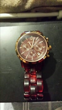 round gold chronograph watch with gold link bracelet Edmonton, T6A 0A4
