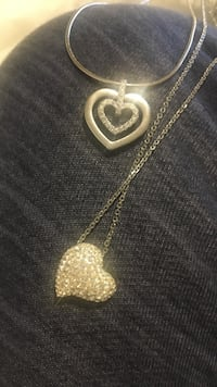 two gold-colored heart pendants