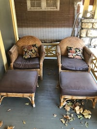 Two brown wooden framed padded armchairs Kansas City, 64110
