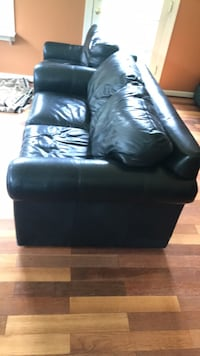 black leather couch and chair