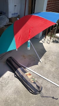 Beautiful almost brand new beach umbrella and beach chair  only use the umbrella once. Both for the price of $23