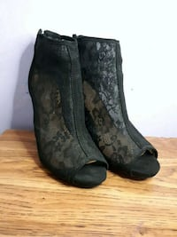pair of black suede wedge booties Calgary, T2A 3E3