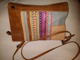 The Sak multicolored fabric and Tan purse, excellent condition