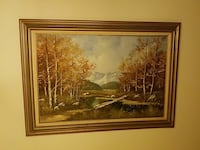 brown forest field painting with brown wooden frame