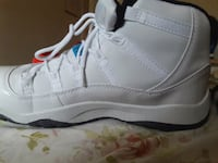 unpaired white and gray Air Jordan 11 shoe Queens, 11385