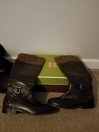 pair of black-and-brown leather knee-high biker boots with box