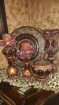 two brown and red candle holders, one canister, and one vase