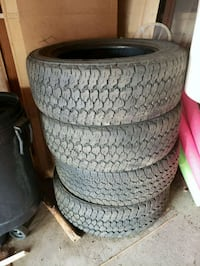 four black rubber car tires Edmonton, T5X 3P4