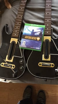 Two black electric guitars