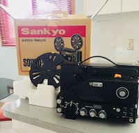 Vintage sankyo super 8 film projector in original packaging.  Includes large projection screen Mississauga, L5B