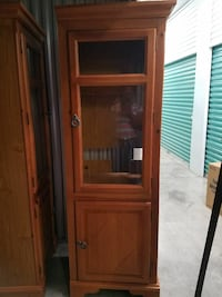brown wooden framed glass display cabinet North Lauderdale, 33068