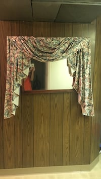 Mirror with curtain