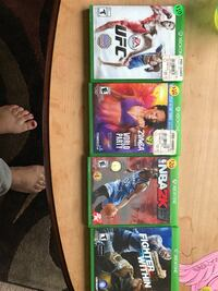 four assorted titled Xbox One game cases