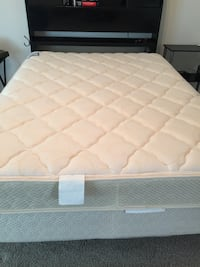 Quilted white mattress with white wooden bed frame Tomball, 77377