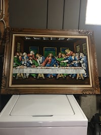 brown wooden framed painting of people Calgary, T2Z 1X6