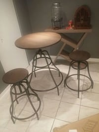 two brown bar stools with table Terrebonne, J6Y 1S1