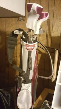 white and red leather golf bag with golf club set 380 mi
