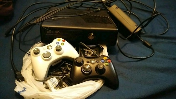 Xbox 360 with 2 controllers  7205f9cb-9b4a-4bce-afc0-0f3db7d9d72c