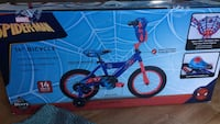 toddler's blue and red bicycle with training wheels 44 km