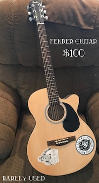 Brown and black acoustic guitar   Shreveport, 71105