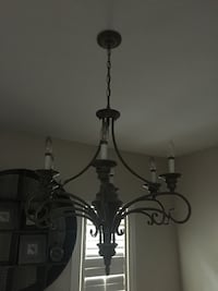 Wrought iron uplight chandelier.