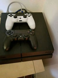 Ps4 with 2 controllers and 4 games. Barely used  Toronto, M4G