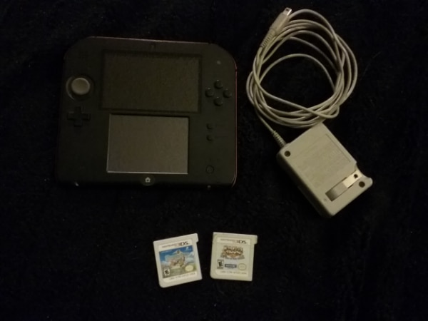 2DS with charger and 2 games