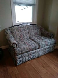 white, green, and red floral fabric loveseat Baltimore, 21225