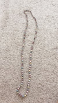 brown and white beaded necklace 30 km