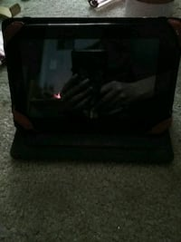 Amazon Kindle. With a red self stand case.  Manassas, 20109