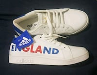 pair of white-and-blue Adidas sneakers 788 km