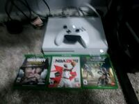 Xbox One console with controller and game cases Davenport, 52806