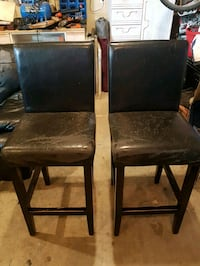 two brown wooden framed black leather padded chairs Cobble Hill, V0R 1L6