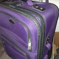 purple and black luggage bag Des Moines