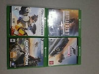 four assorted Xbox One game cases 300 mi