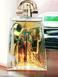 gold Givenchy handbag fragrance bottle