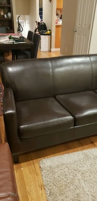 Free Dark brown faux leather couch