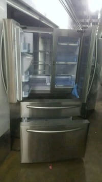 gray and black top mount refrigerator