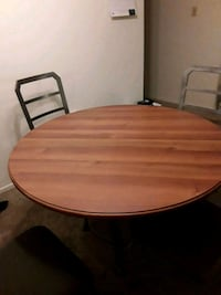 round brown wooden table with two chairs Baton Rouge, 70808