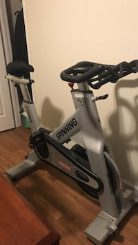 Grey and black spinning spin bike price negotiable