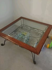 rectangular brown wooden framed glass top coffee table Boxborough