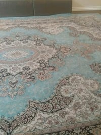 white, blue, and brown floral area rug Port Coquitlam