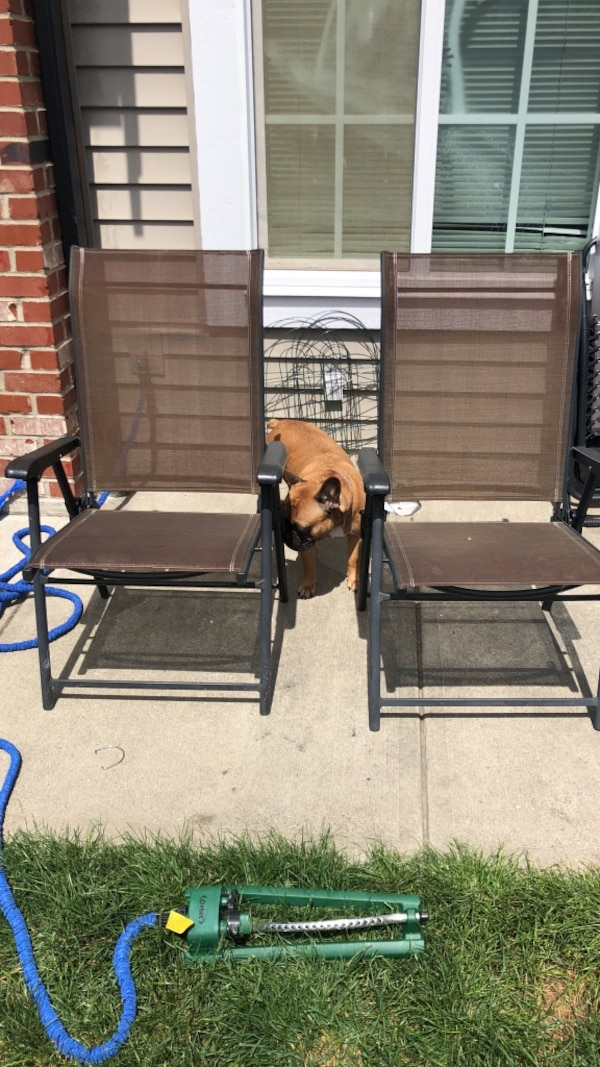 Two brown lawn chairs