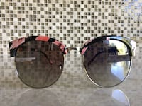two brown and black framed sunglasses