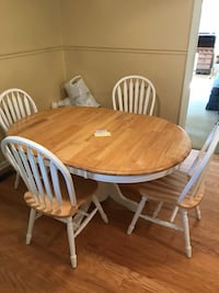 oval brown wooden table with four windsor chairs dining set Murfreesboro, 37128