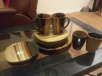four brown ceramic mugs and saucers Houston, 77002