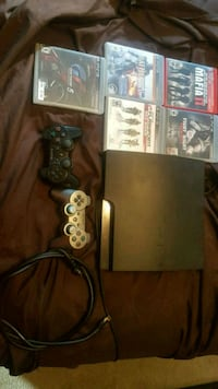 black Sony PS3 slim console with controller and game cases Guelph, N1H 6H9
