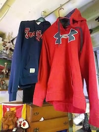 red and blue Under Armour and Footloose pullover hoodies